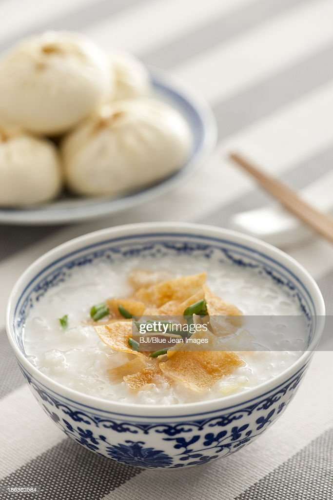 Chinese food rice porridge and steamed buns : Stock Photo