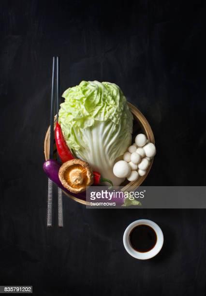 Chinese food uncooked vegan food on black background.