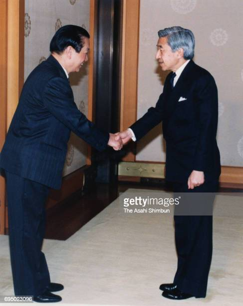 Chinese Foreign Minister Qian Qichen and Emperor Akihito shake hands prior to their meeting at the Imperial Palace on April 2 1996 in Tokyo Japan