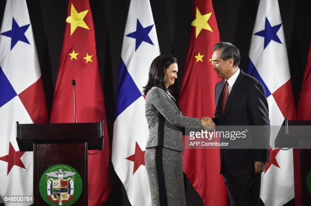 Chinese Foreign Minister Wang Yi and his Panamanian counterpart Isabel De Saint Malo shake hands during a press conference at the Simon Bolivar...