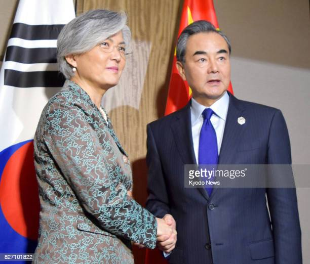 Chinese Foreign Minister Wang Yi and his South Korean counterpart Kang Kyung Wha shake hands in Manila on Aug 6 2017 Wang said during their meeting...