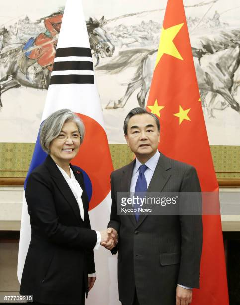 Chinese Foreign Minister Wang Yi and his South Korean counterpart Kang Kyung Wha shake hands ahead of their talks at the Diaoyutai State Guesthouse...