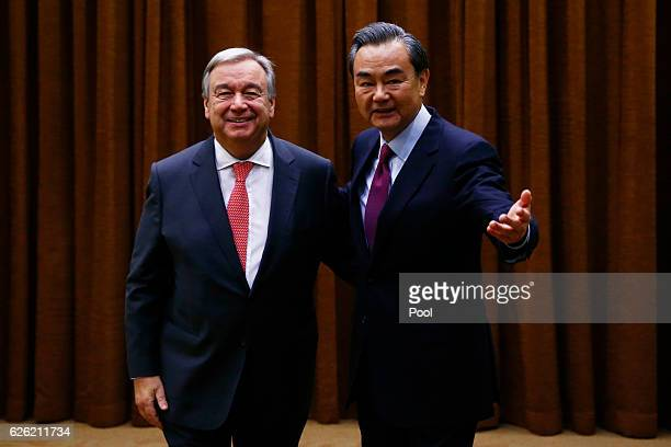 Chinese Foreign Minister Wang Yi and UN SecretaryGeneraldesignate Antonio Guterres meet at the foreign ministry on November 28 2016 in Beijing China...