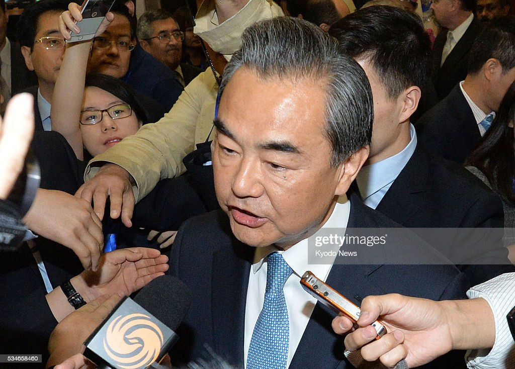 Chinese Foreign Minister <a gi-track='captionPersonalityLinkClicked' href=/galleries/search?phrase=Wang+Yi+-+Politician&family=editorial&specificpeople=13620429 ng-click='$event.stopPropagation()'>Wang Yi</a> answers reporters' questions at the ministry in Beijing on May 27, 2016, ahead of U.S. President Barack Obama's historic visit to Hiroshima later in the day. Wang said he feels sorry for the victims of the 1945 U.S. atomic bombing of the Japanese city but the Chinese people killed by Japanese troops in the 1937 Nanjing Massacre should not be forgotten.