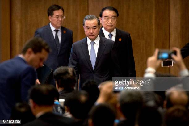 Chinese Foreign Minister Wang Yi arrives for the opening ceremony of the BRICS Business Forum at the Xiamen International Conference and Exhibition...