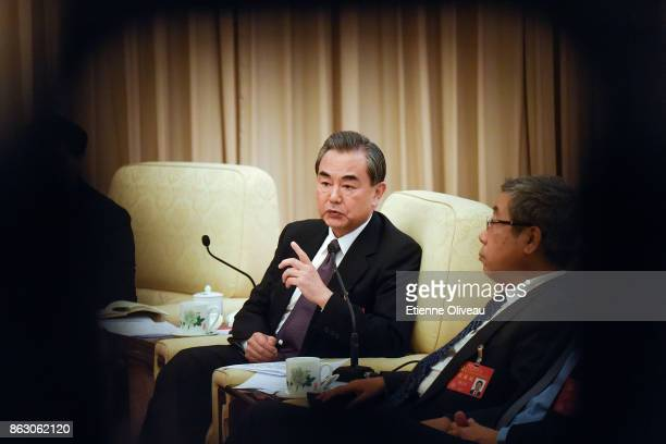 Chinese Foreign Minister Wang Yi attends a meeting of the 19th Communist Party Congress at the Great Hall of the People on October 19 2017 in Beijing...