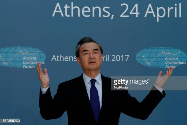 Chinese Foreign Minister Wang Yi gestures posing for a picture during the quotAncient Civilizations Forumquot at Zappeion Hall in Athens Greece on...
