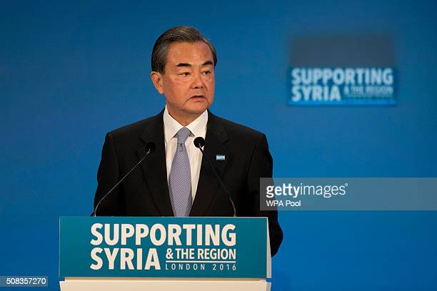 Chinese Foreign Minister Wang Yi makes a pledge during the second cohost chaired thematic pledging session for jobs and economic development during...