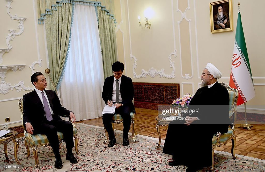 Chinese Foreign Minister Wang Yi meets with Iranian President Hassan Rouhani at the Iranian presidency office in Tehran Iran on February 15 2015