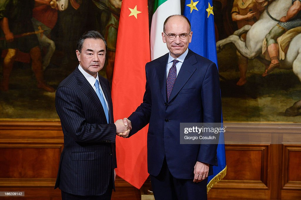 Chinese foreign minister Wang Yi (L) meets with Italian Prime Minister <a gi-track='captionPersonalityLinkClicked' href=/galleries/search?phrase=Enrico+Letta&family=editorial&specificpeople=2915592 ng-click='$event.stopPropagation()'>Enrico Letta</a> at Palazzo Chigi on October 29, 2013 in Rome, Italy. Wan Yi is on an official visit to Italy.