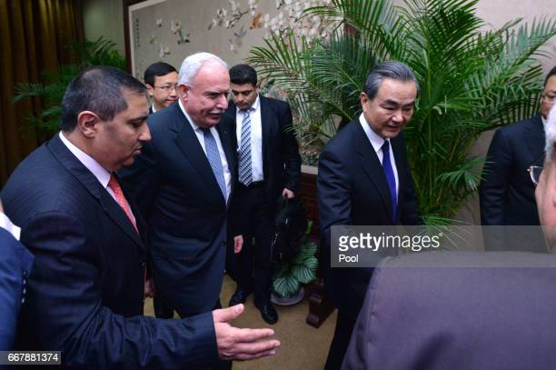 Chinese Foreign Minister Wang Yi right and his Palestinian counterpart Riyad AlMaliki walk for their meeting at the Ministry of Foreign Affairs on...