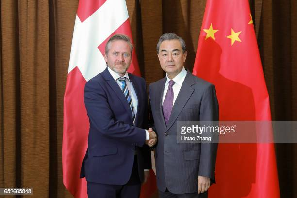 Chinese Foreign Minister Wang Yi shakes hands with Denmark's Foreign Minister Anders Samuelsen before during their meeting at the Ministry of Foreign...