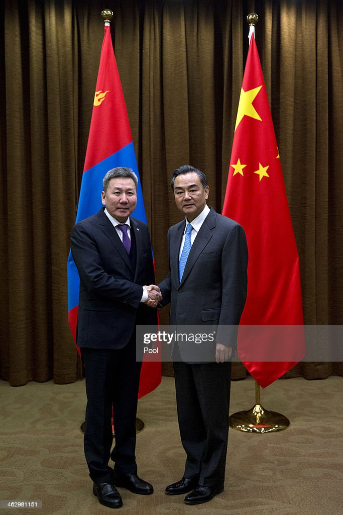 Chinese Foreign Minister Wang Yi (R) shakes hands with Mongolian Foreign Minister Luvsanvandan Bold before their meeting at China's Ministry of Foreign Affairs on January 16, 2014 in Beijing, China. Bold is on an official visit to China from January 16-21.