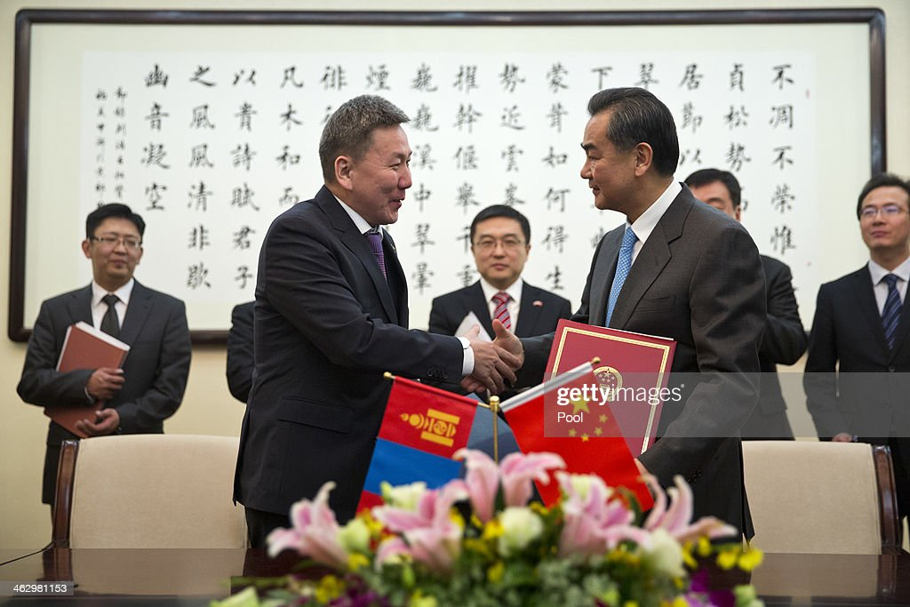 Chinese Foreign Minister Wang Yi (R) shakes hands with Mongolian Foreign Minister Luvsanvandan Bold (L) after they signed agreements at China's Ministry of Foreign Affairs on January 16, 2014 in Beijing, China. Bold is on an official visit to China from January 16-21.