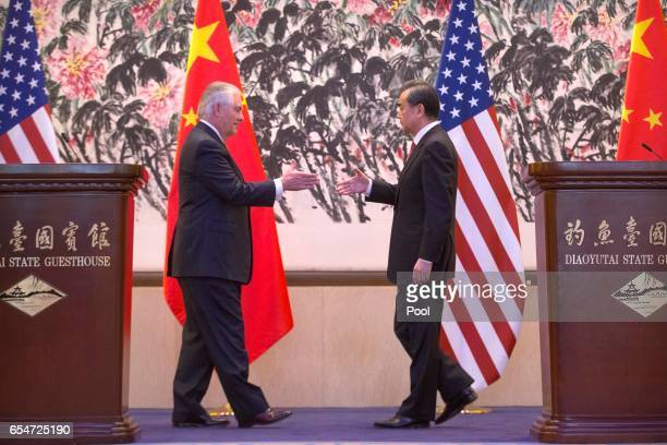 Chinese Foreign Minister Wang Yi shakes hands with US Secretary of State Rex Tillerson after a joint press conference at Diaoyutai State Guesthouse...