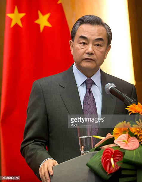 Chinese Foreign Minister Wang Yi speaks during a joint press conference with Swiss Foreign Minister Didier Burkhalter not shown at the Ministry of...
