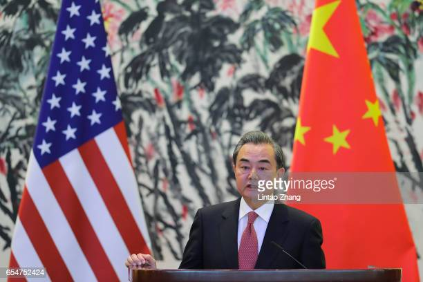 Chinese Foreign Minister Wang Yi speaks during a joint press conference with US Secretary of State Rex Tillerson at Diaoyutai State Guesthouse on...
