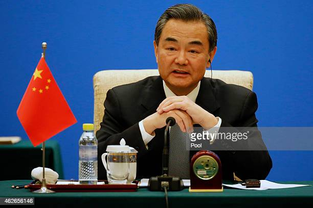 Chinese Foreign Minister Wang Yi speaks during the 13th trilateral meeting of Foreign Ministers from Russia India and China at Diaoyutai State...