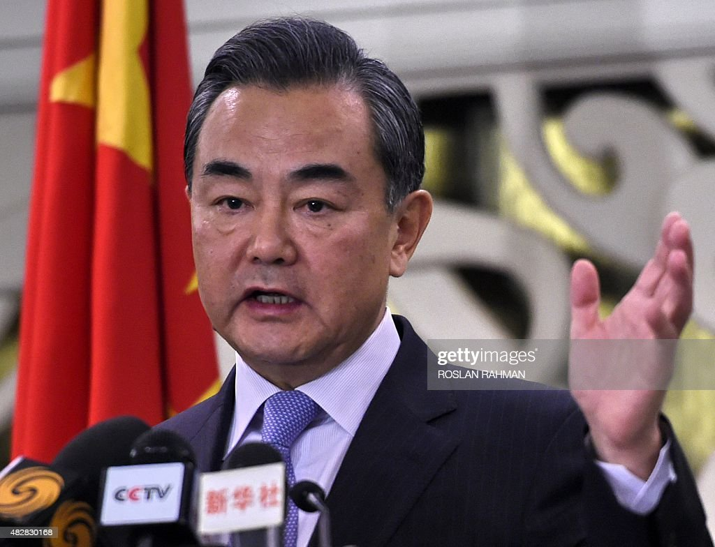 Chinese Foreign Minister Wang Yi speaks to journalists during a press conference after meeting his Singaporean counterpart K Shanmugam in Singapore...