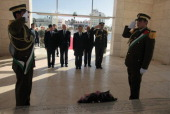 Chinese Foreign Minister Wang Yi stands after laying a wreath at the tomb of the late Palestinian leader Yasser Arafat at the Muqataa the Palestinian...