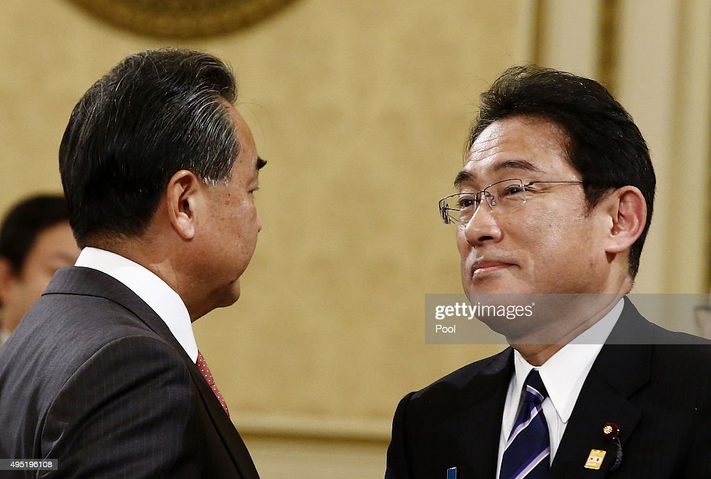 Chinese Foreign Minister <a gi-track='captionPersonalityLinkClicked' href=/galleries/search?phrase=Wang+Yi+-+Pol%C3%ADtico&family=editorial&specificpeople=13620429 ng-click='$event.stopPropagation()'>Wang Yi</a> (L) talks with Japanese foreign minister <a gi-track='captionPersonalityLinkClicked' href=/galleries/search?phrase=Fumio+Kishida&family=editorial&specificpeople=10093794 ng-click='$event.stopPropagation()'>Fumio Kishida</a> (R) before the sixth trilateral summit meeting at the presidential Blue House on November 1, 2015 in Seoul, South Korea. President Park Geun-hye, Japanese Prime Minister Shinzo Abe and Chinese Premier Li Keqiang gathered in Seoul to hold a trilateral summit for the first time in three years. The issues to be discussed include the trilateral free trade agreement, perceptions on wartime history, and territorial disputes.