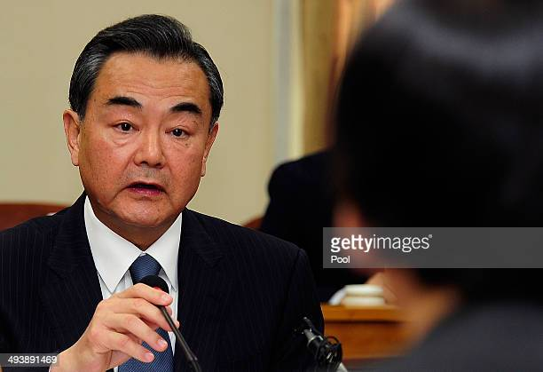Chinese Foreign Minister Wang Yi talks with South Korean Foreign Minister Yun Byungse during their meeting on May 26 2014 in Seoul South Korea The...