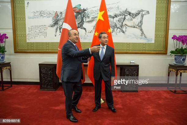 Chinese Foreign Minister Wang Yi with Turkish Foreign Minister Mevlut Cavusoglu during their meeting at Diaoyutai State Guesthouse August 3 2017 in...