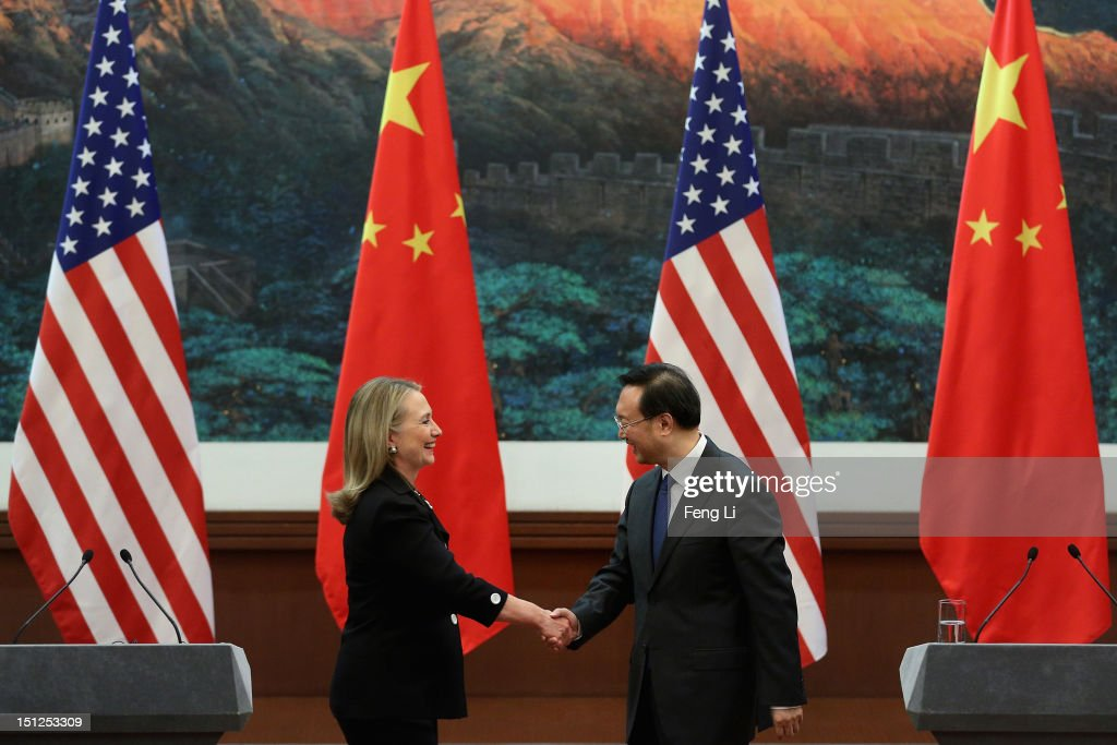 Chinese Foreign Minister <a gi-track='captionPersonalityLinkClicked' href=/galleries/search?phrase=Yang+Jiechi&family=editorial&specificpeople=555098 ng-click='$event.stopPropagation()'>Yang Jiechi</a> (R) and U.S. Secretary of State <a gi-track='captionPersonalityLinkClicked' href=/galleries/search?phrase=Hillary+Clinton&family=editorial&specificpeople=76480 ng-click='$event.stopPropagation()'>Hillary Clinton</a> (L) shake hands after attending the press conference at the Great Hall of the People on September 5, 2012 in Beijing, China. Secretary Clinton will urge the Chinese to use a collective diplomatic approach in solving terriorial disputes with its neighbors.