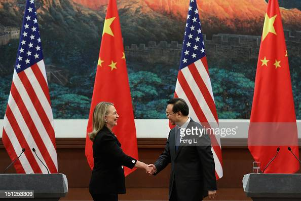 Chinese Foreign Minister Yang Jiechi and US Secretary of State Hillary Clinton shake hands after attending the press conference at the Great Hall of...