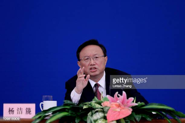 Chinese Foreign Minister Yang Jiechi answers a question during a news conference at The Great Hall Of The People on March 7 2011 in Beijing China...