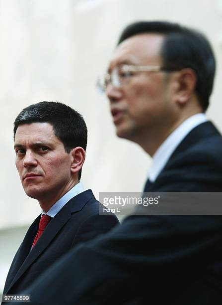 Chinese Foreign Minister Yang Jiechi answers questions from the media as UK Foreign Secretary David Miliband looks on after a meeting at Chinese...
