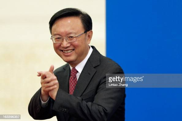 Chinese Foreign Minister Yang Jiechi greets the media as he arrives for a press conference at the Great Hall of the People on March 9 2013 in Beijing...