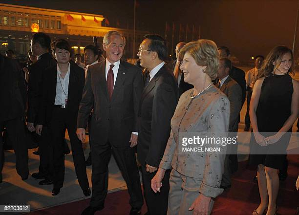 Chinese Foreign Minister Yang Jiechi greets US President George W Bush First Lady Laura Bush and their daughter Barbara Bush upon their arrival on...
