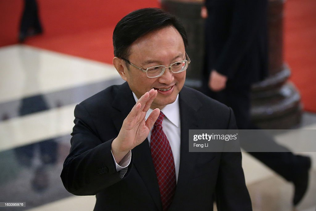 Chinese Foreign Minister Yang Jiechi (L) waves as he leaves a news conference in Beijing's Great Hall of the People on March 9, 2013 in Beijing, China. China's new president will pay his maiden state visits to Russia, Tanzania, South Africa and the Republic of Congo and attend the fifth leaders' summit of BRICS countries in Durban, said Foreign Minister Yang Jiechi on Saturday.
