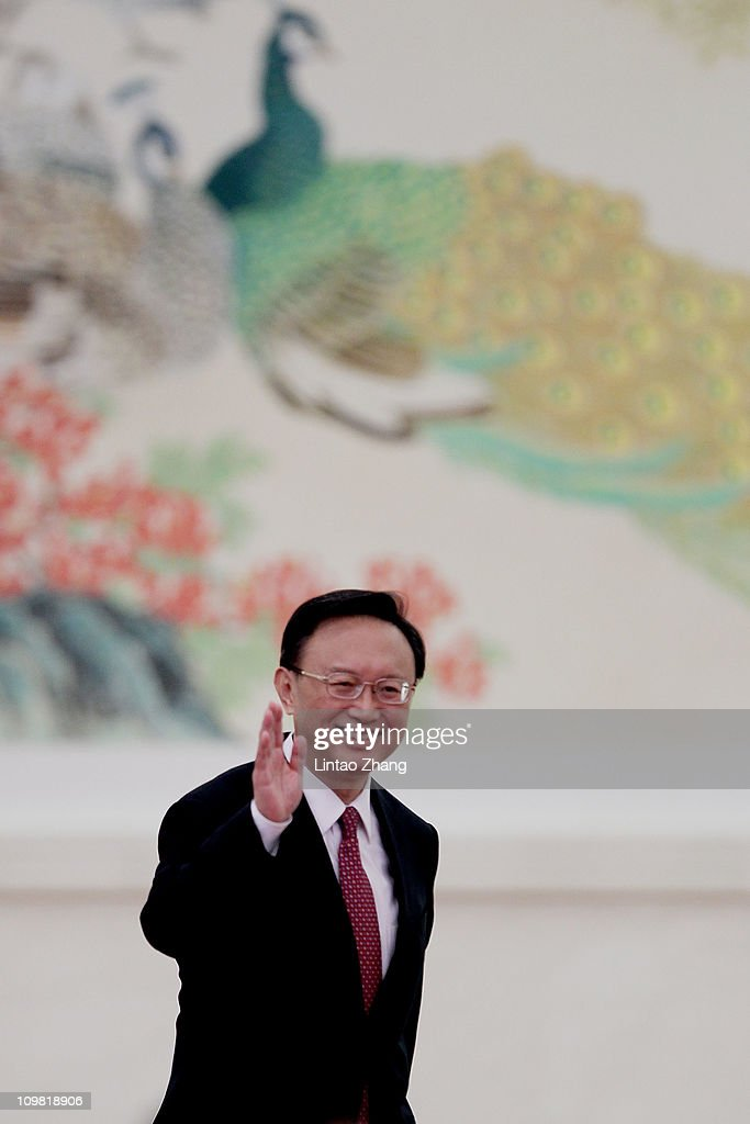 Chinese Foreign Minister Yang Jiechi waves during a news conference at The Great Hall Of The People on March 7, 2011 in Beijing, China. Yang voiced Beijing's firm opposition to the sale of US arms by Washington to Taiwan, saying the US government 'should take concrete measures to support the peaceful development of cross-Strait relations'.