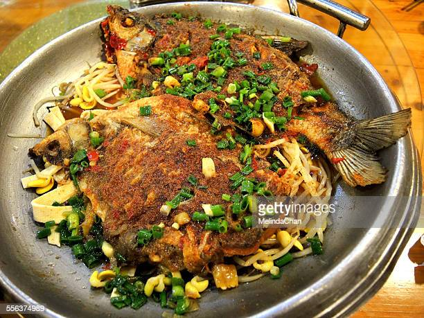 Chinese fried fish in wok