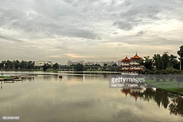 Chinese Garden At Lakeshore Against Cloudy Sky