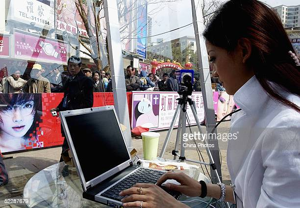 A Chinese girl competes at online survival challenge on March 7 2005 in Kunming of Yunnan Province China Five female contestants attend the...