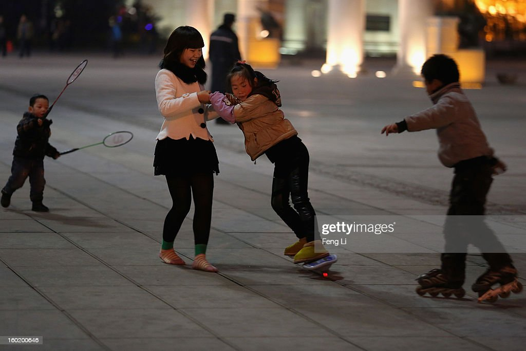 A Chinese girl learns to play skateboard at a square on January 27, 2013 in Guiyang of Guizhou Province, China.