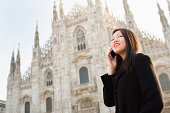 Chinese girl on the phone in Piazza Duomo, Milan, Italy