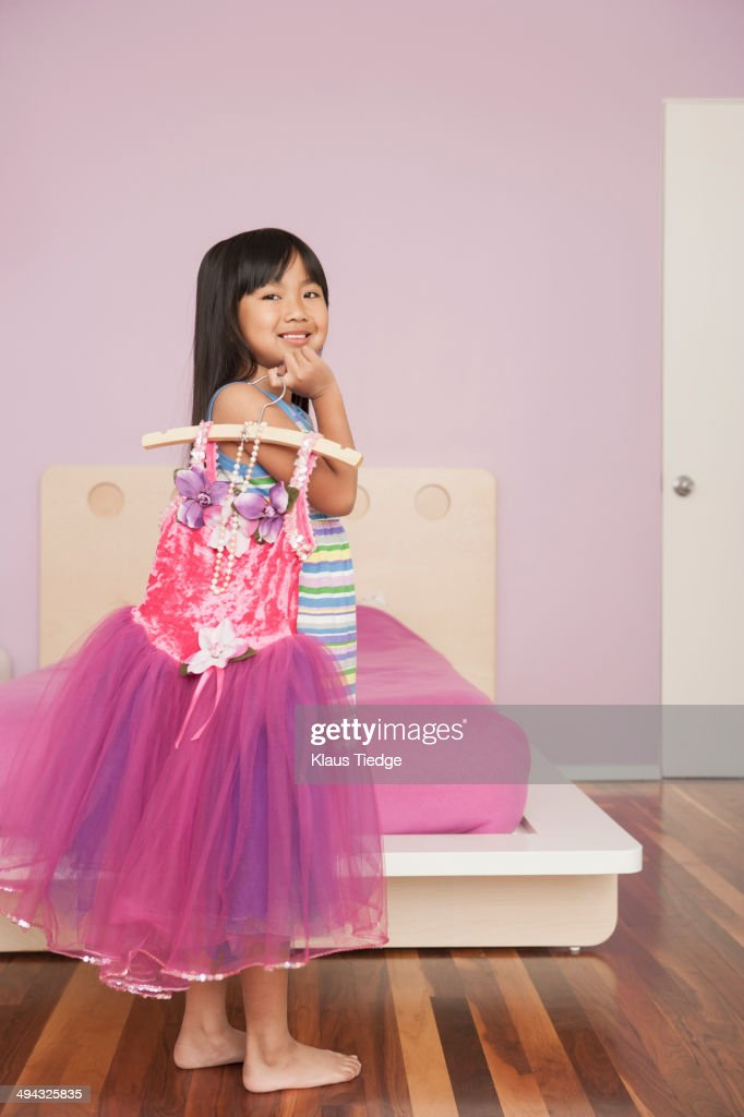chinese girl playing dressup in bedroom stock photo