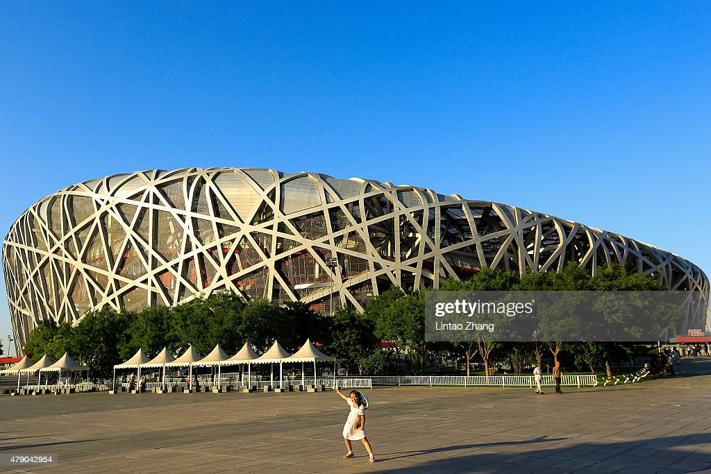 Chinese girl poses for a photo outside the China National Stadium also known as Bird's Nest on June 30 2015 in Beijing China 2015 IAAF World...