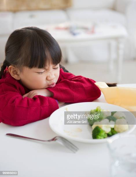 Chinese girl refusing to eat vegetables