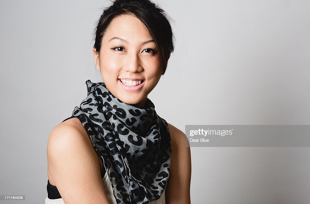 Chinese girl smiles towards the camera