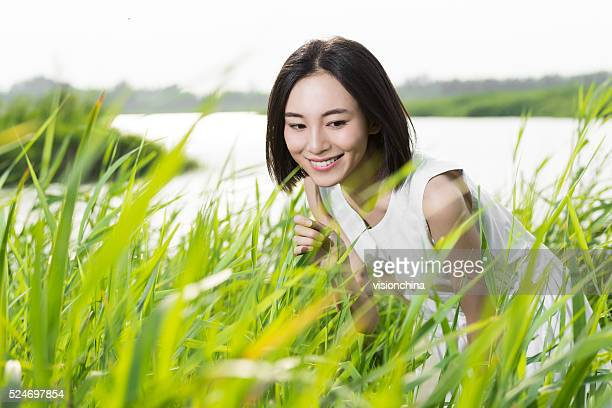 chinese girl standing lake