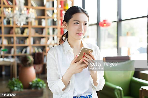 chinese girl using mobile phone