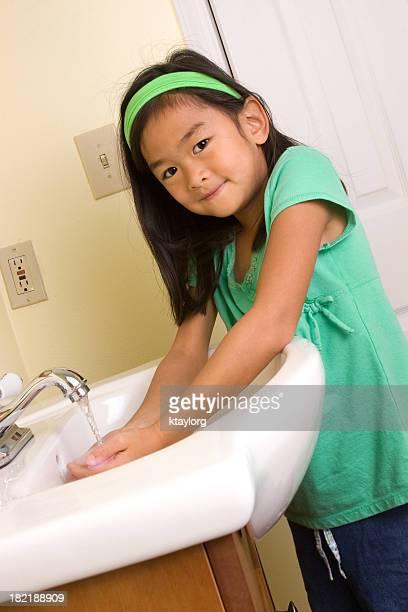 Chinese girl washing hands
