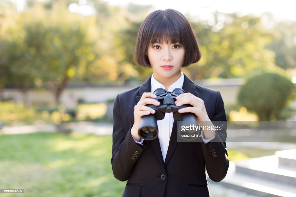 [Image: chinese-girl-wearing-a-black-suit-his-ha...d668569276]