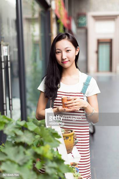 chinese girl wearing an apron