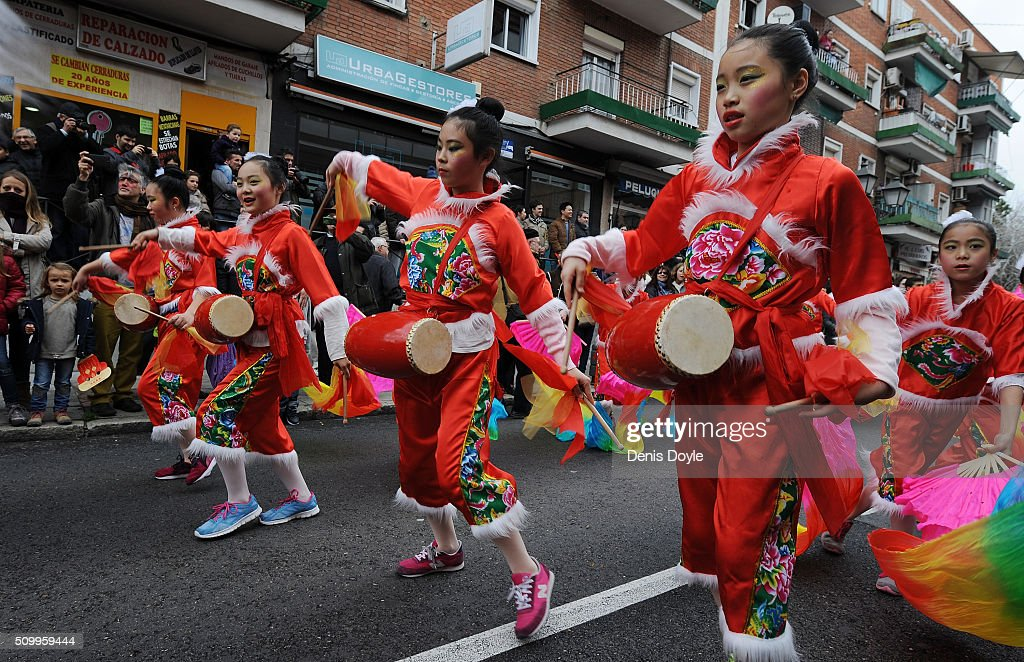 Chinese girls dance during the procession to celebrate The Year of The Monkey on February 13, 2016 in Madrid, Spain. The Madrid Town Hall organised this year's lunar year celebrations for the first time in Madrid's Chinatown district of Usera.